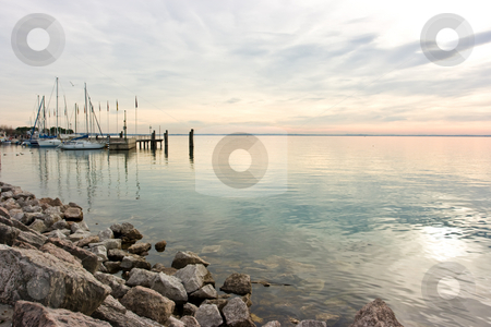 Pastel sunset stock photo, Pastel tones during sunset over lake Garda by Natalia Macheda