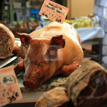 Piglet on a market stock photo, Piglet baken as a whole. For sale on a french market by Natalia Macheda