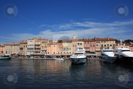 Saint Tropez quay 3 stock photo, Marine view of Saint Tropez quay with luxury yachts and colorful ancient houses by Natalia Macheda