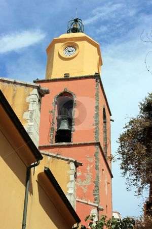 Saint Tropez clock stock photo, Saint Tropez clock on a colorful tower with a bell. by Natalia Macheda