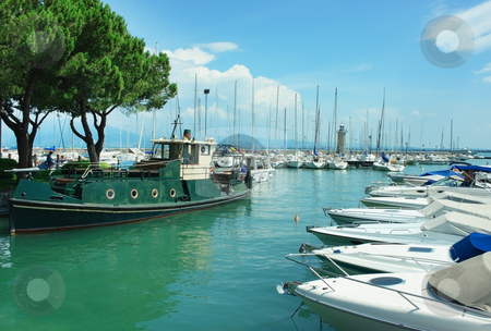 Desenzano harbor stock photo, Small harbor with lighthouse and boats in Desenzano near lake Garda by Natalia Macheda
