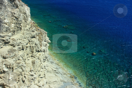 Wild tropical beach stock photo, Remote tropical beach under precipitous cliff by Natalia Macheda