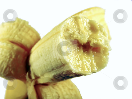 Bitten banana stock photo, A close up of a bitten banana over white by Ivan Paunovic