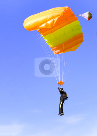 Orange parachute stock photo, An orange parachute in a blue sky on a sunny day by Ivan Paunovic