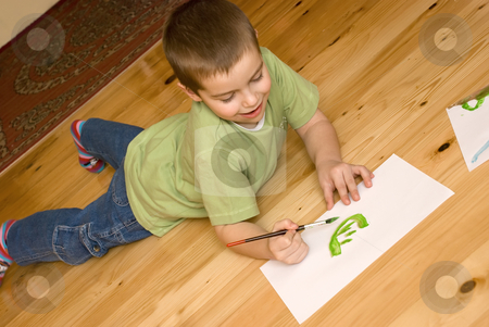 Boy artist stock photo, A boy is painting on the floor by Ivan Paunovic