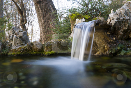 Water spring stock photo, Long exposure photo of an water spring with small waterfall by Ivan Paunovic