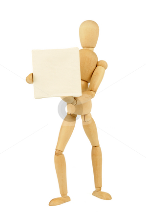 Wooden figurine stock photo, A wooden figurine holding a white  canvas by Csaba Zsarnowszky