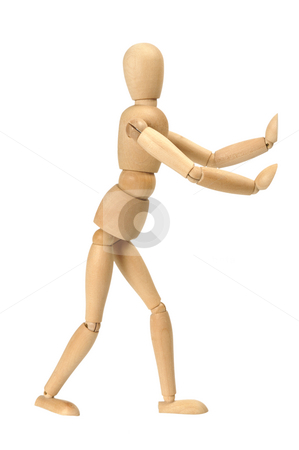Figurine stock photo, Wooden figurine in pushing position isolated on white by Csaba Zsarnowszky