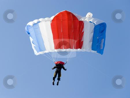 Pulling brakes stock photo, A parachutist pulling brakes above us by Ivan Paunovic