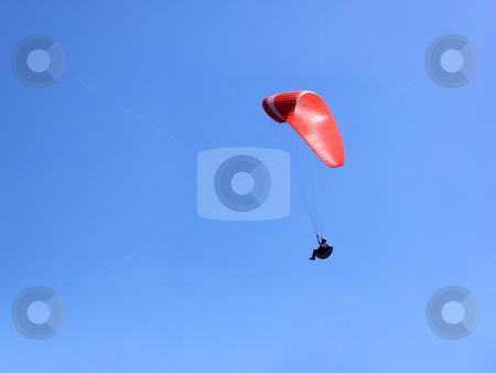 Red-white paraglider stock photo, Paraglider flying over us in the blue sky by Ivan Paunovic