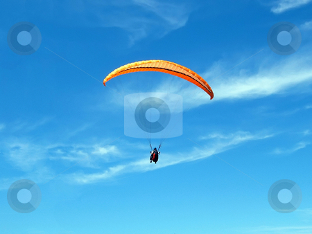 Paragliding stock photo, Paraglider on a blue sky with thin clouds by Ivan Paunovic