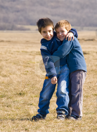 Boys hugging stock photo, Two boys hugging on a sunny day by Ivan Paunovic