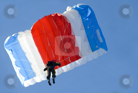Parachute stock photo, A parachutist pulling brakes above us by Ivan Paunovic