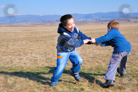 Young boys spinning stock photo, Two happy boys spinning on a sunny day by Ivan Paunovic
