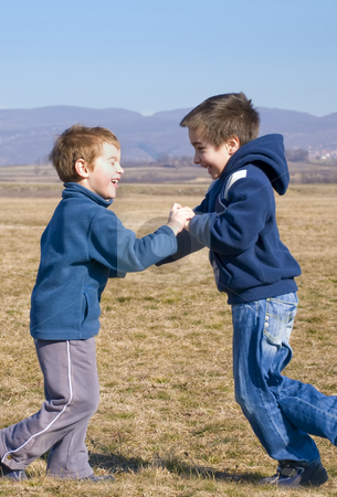 Meeting stock photo, Two boy meet each other outside and laugh by Ivan Paunovic