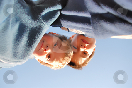 Boys looking down stock photo, Two boys play outside. They are looking down at us and we are on the ground by Ivan Paunovic