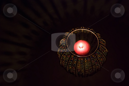 Candle in container stock photo, A candle in a candleholder in the dark by Ivan Paunovic