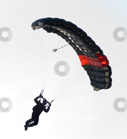 Black parachute stock photo, A black parachute in a skylight. the sun is almost behind it by Ivan Paunovic