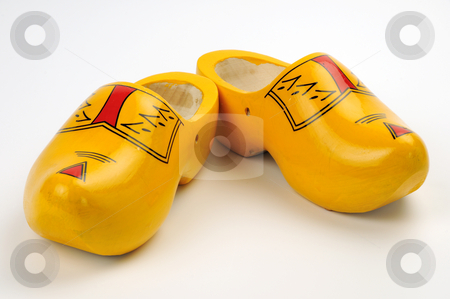 Wooden shoes stock photo, Hand made wooden dutch clugs isolated on white by Csaba Zsarnowszky