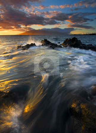 Overflow stock photo, A coastal cauldron overflowing with the ssun setting on the Mountains of West Maui in the distance by Mike Dawson