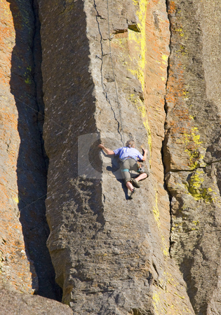 Up She Goes stock photo, A climber headed up the basalt columns of a cliff in the Tieton River Canyon by Mike Dawson