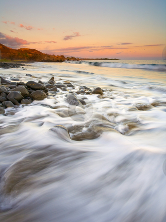 Sunset Tides stock photo, Tides rolling shore as the sun sets over a rocky beach near Lahaina on Maui. by Mike Dawson
