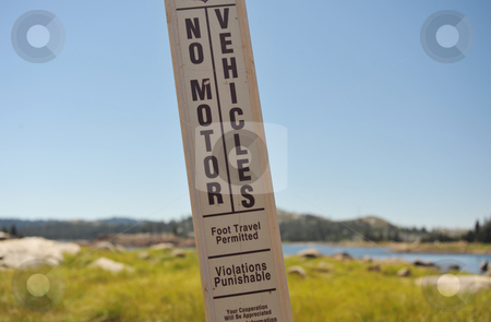 No Motor Vehicles stock photo, A No Motor Vehicles sign stand at the shoreline of a Sierra lake by Lynn Bendickson