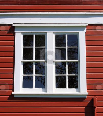 White Framed Barn Window stock photo, White framed window on an old red barn. by Steve Stedman