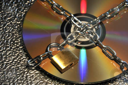 Data security stock photo, CD and padlock with chain by Csaba Zsarnowszky