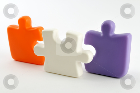 Puzzle pieces stock photo, Three colorful puzzle pieces isolated on white by Csaba Zsarnowszky