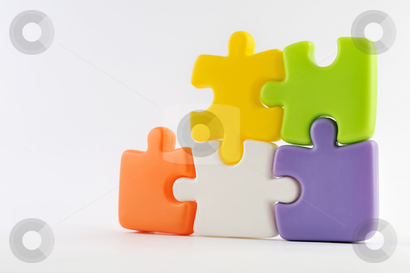 Puzzle pieces together stock photo, Puzzle pieces together isolated on white by Csaba Zsarnowszky