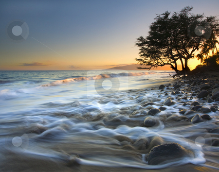 Ebb & Flow stock photo, The setting sun adds color to  slice of beach off the South coast of Maui near Lahaina. The ebb flow of the rising tides evident in the foreground where the water is ebbing and middle where a waves begins to curl as it comes ashore by Mike Dawson