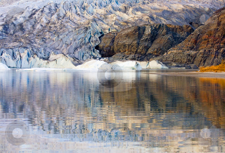 Glacial Reflections stock photo, Mendenhall Glacier reflecting in the waters of Mendenhall Lake on an October Afternoon by Mike Dawson