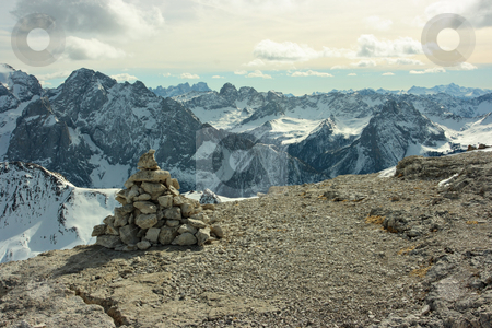 Touristic stone pyramid stock photo, Touristic stone pyramid against Dolomites range. View from the point of 3000m. by Natalia Macheda