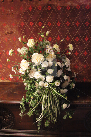 White flowers in ancient interior stock photo, Bouquet of white flowers agains the wall with frescos of XIV century by Natalia Macheda