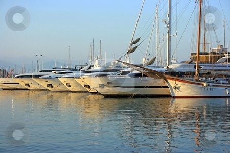 Yachts in fort stock photo, Modern and ancient yachts in port of Antibes city (French riviera) by Natalia Macheda