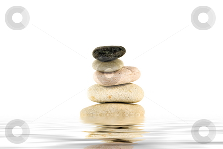 Zen stone reflection stock photo, Five stones in equilibrium isolated over white reflecting in water flood. by Natalia Macheda