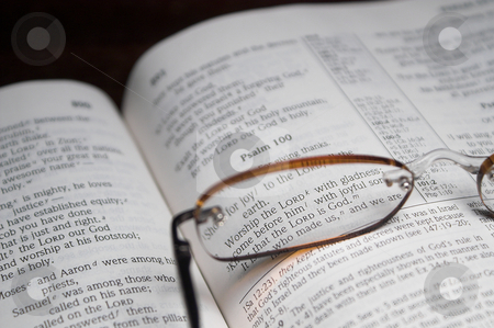 Bible Verses stock photo, Scriprure verses inside of a holy bible and reading glasses. by Robert Byron