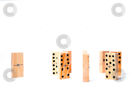 Domino Outcast stock photo, A group of dominos that won't let another domono in. by Robert Byron