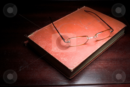 Book and Reading Glasses stock photo, Reading glasses and a book full of words and phrases. by Robert Byron