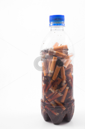 Cigarette Bottle stock photo, A bottle used as a refuse container for cigarette butts. by Robert Byron