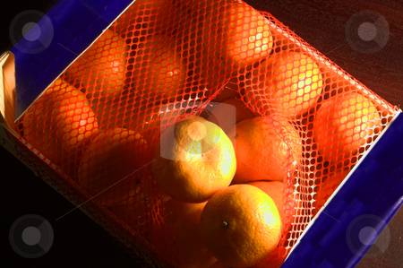 Clementines stock photo, A box of delicious and tiny clementine oranges. by Robert Byron