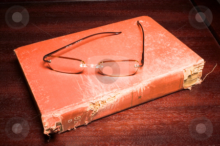 Book and eading Glasses stock photo, Reading glasses and a book full of words and phrases. by Robert Byron
