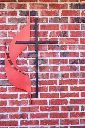 Cross stock photo, A Christian cross on the side of a building. by Robert Byron