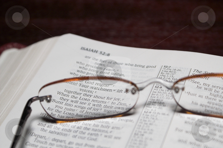 Bible Verse stock photo, Reading glasses magnifying scripture in a bible. by Robert Byron