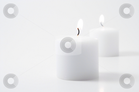 Candles stock photo, Candles burning for who knows why. by Robert Byron
