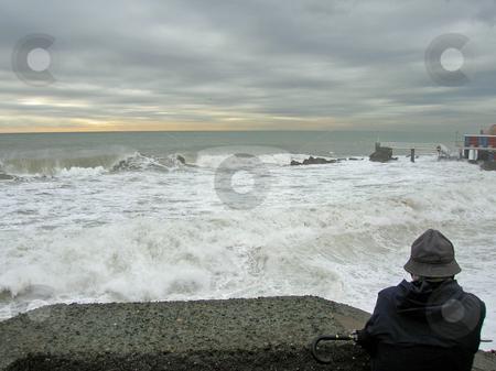 Man in front of giant waves stock photo, Mareggiata a genova by Andrea Morando