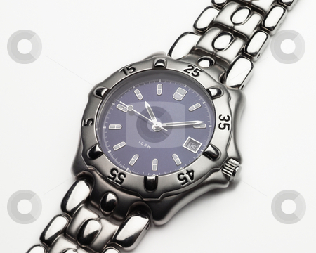Men's Dress Watch stock photo, Men's stainless steel and cobalt blue dress wristwatch by A Cotton Photo