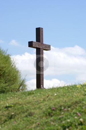 Christianism stock photo, Wood cross at the top of the green hill by Serge VILLA