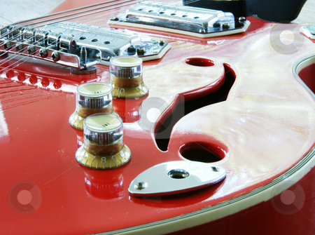 Red guitar stock photo, A closeup of a red acoustic electric guitar by Sam Sapp